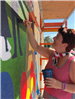 Woman Working on Mural