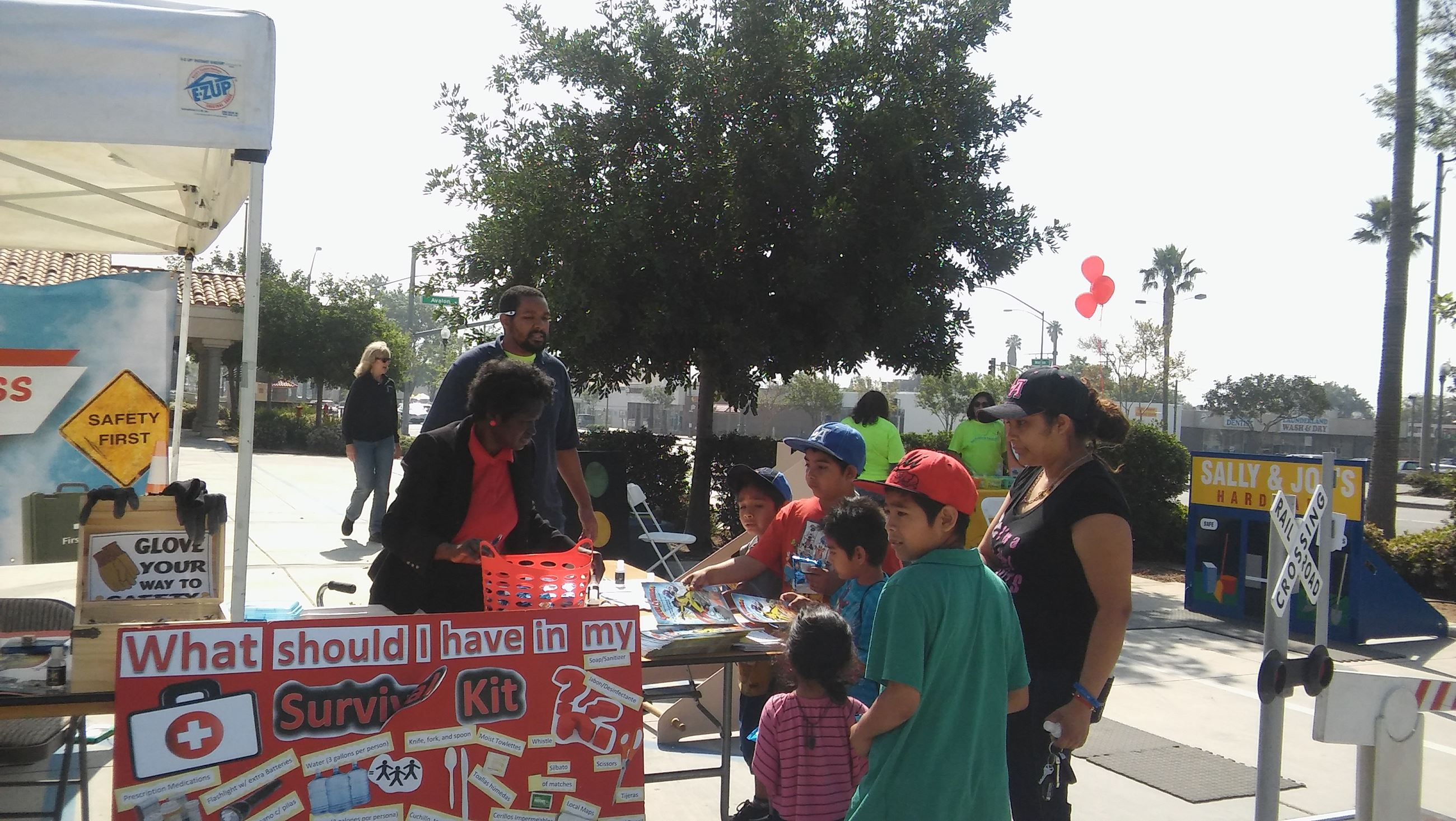 "Children Visit the ""What Should I Have in My Survival Kit"" Booth at Event"